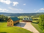 Stunning Log Home with Creek Frontage and 120 acres